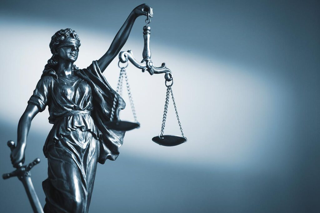 Figure justice woman holding scales sword