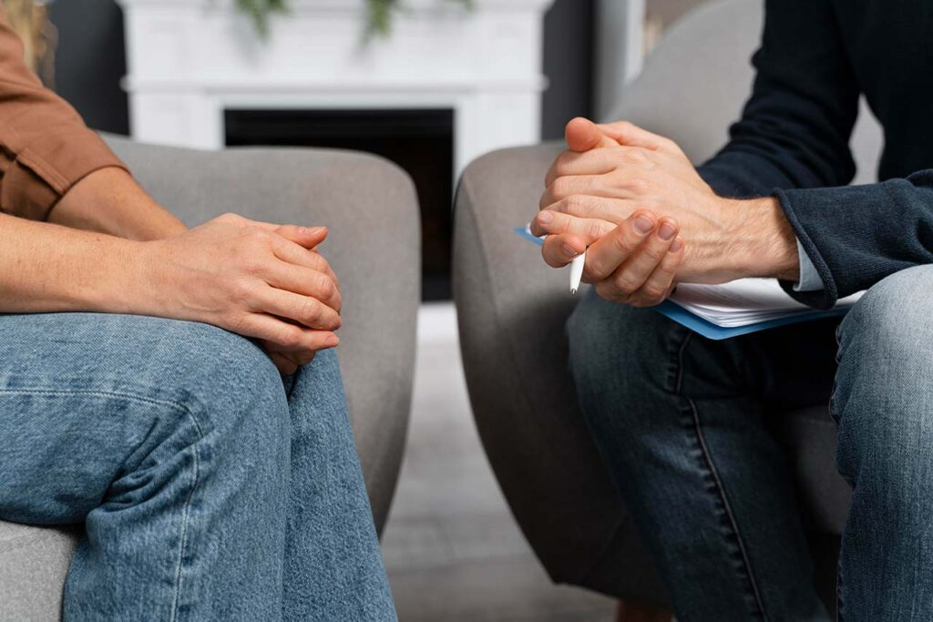 Woman counselor holding hands together