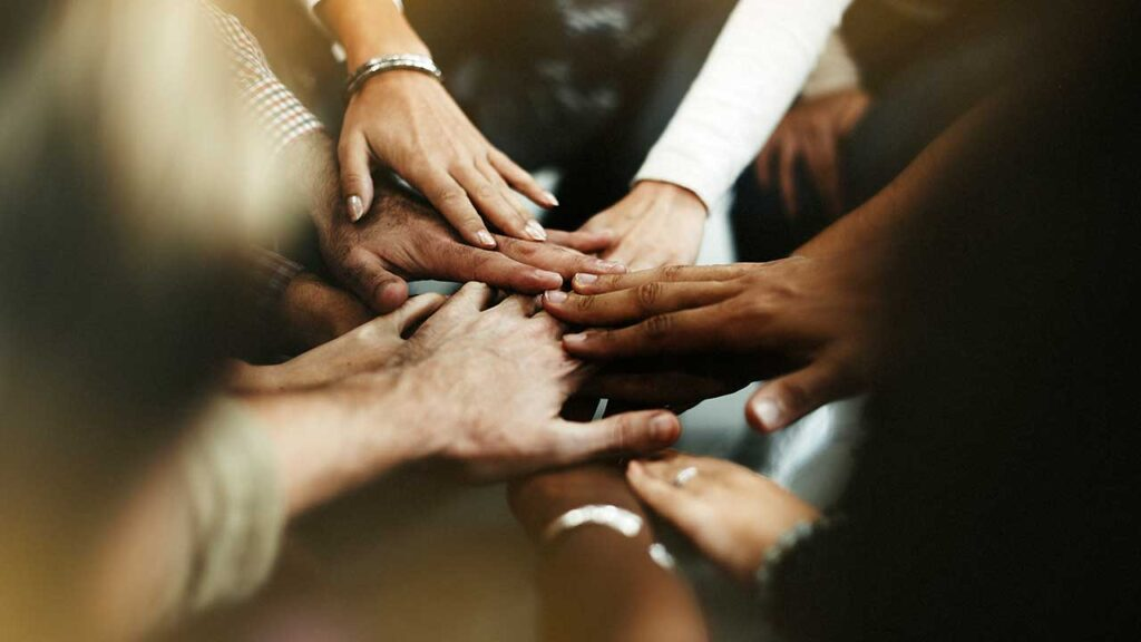 closeup-diverse-people-joining-their-hands